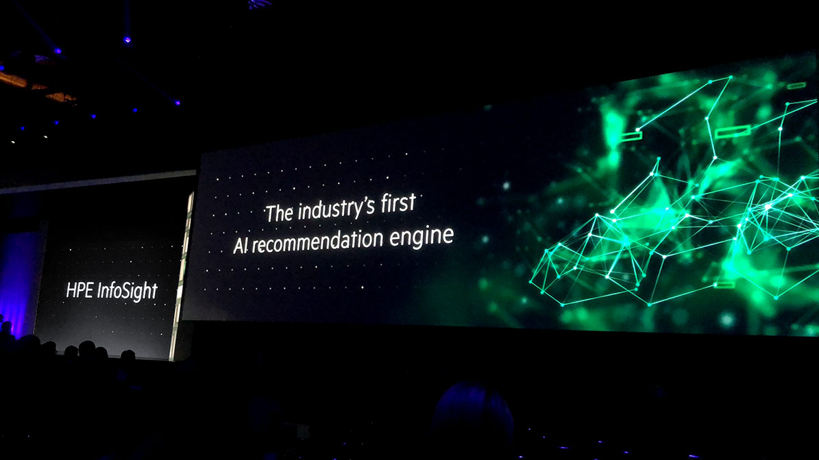 "Screens at HPE Discover reading ""HPE InfoSight"" and ""The industry's first AI recommendation engine"""