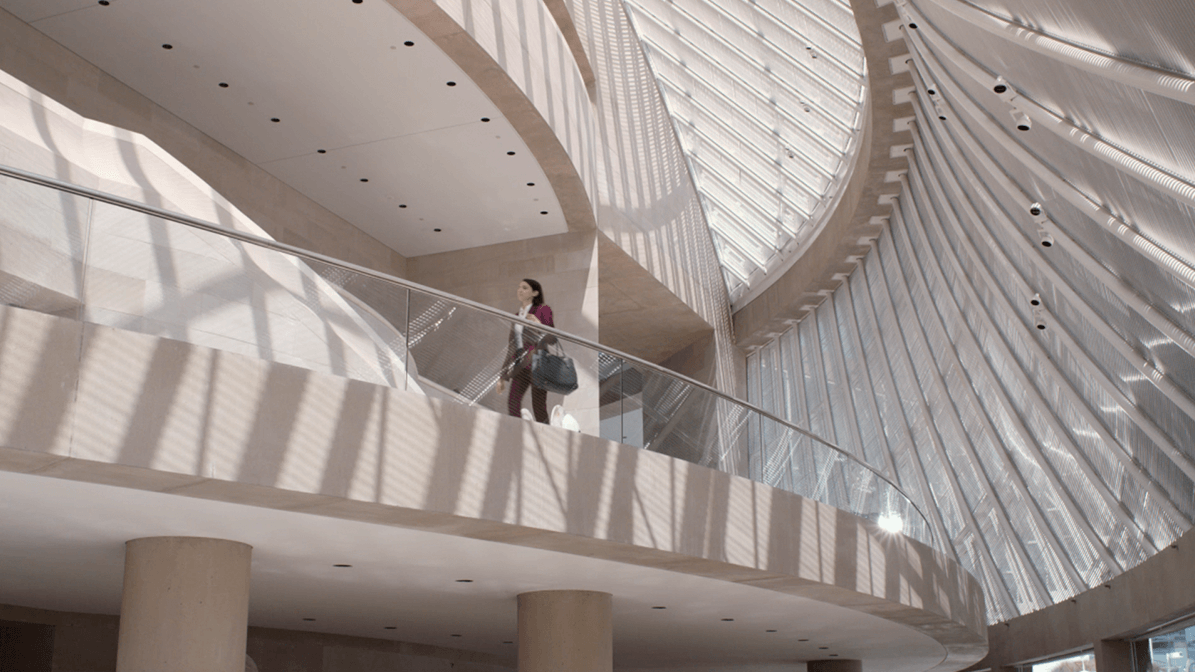 Professional woman going up the stairs inside building