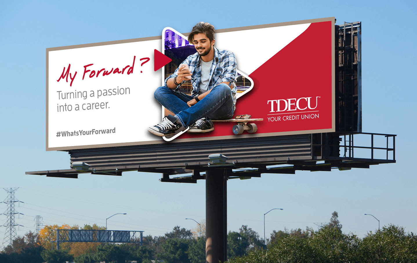 "Mockup of future billboard with ""Forward"" campaign where it shows a young student with the following caption: ""My Forward? Turning a vision into a career. #WhatsYourForward"""