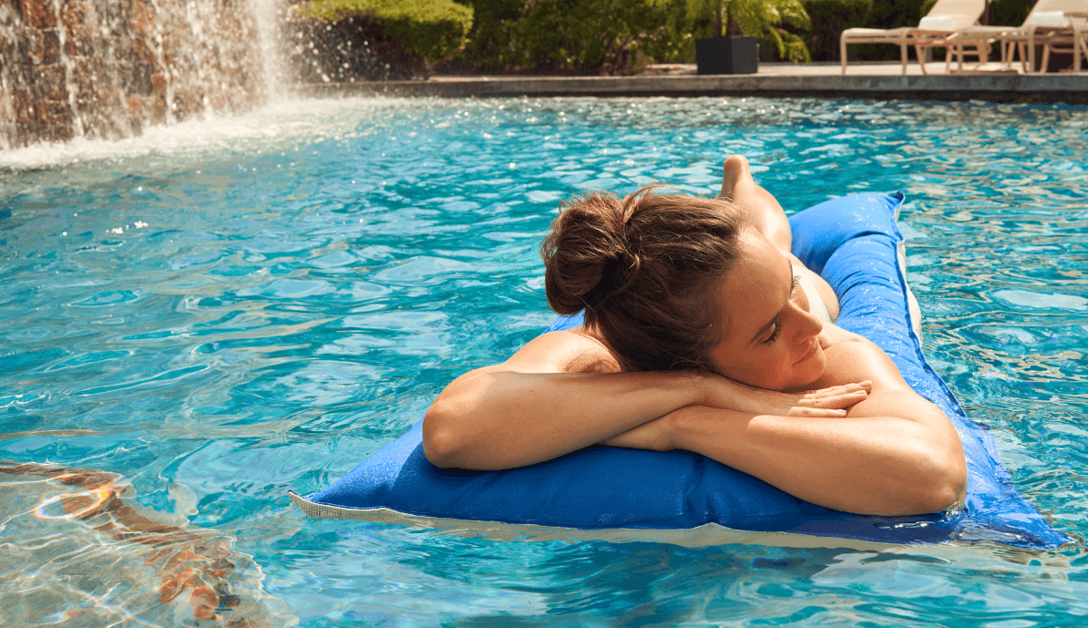 Woman swimming in a pool at a Woodlands hotel