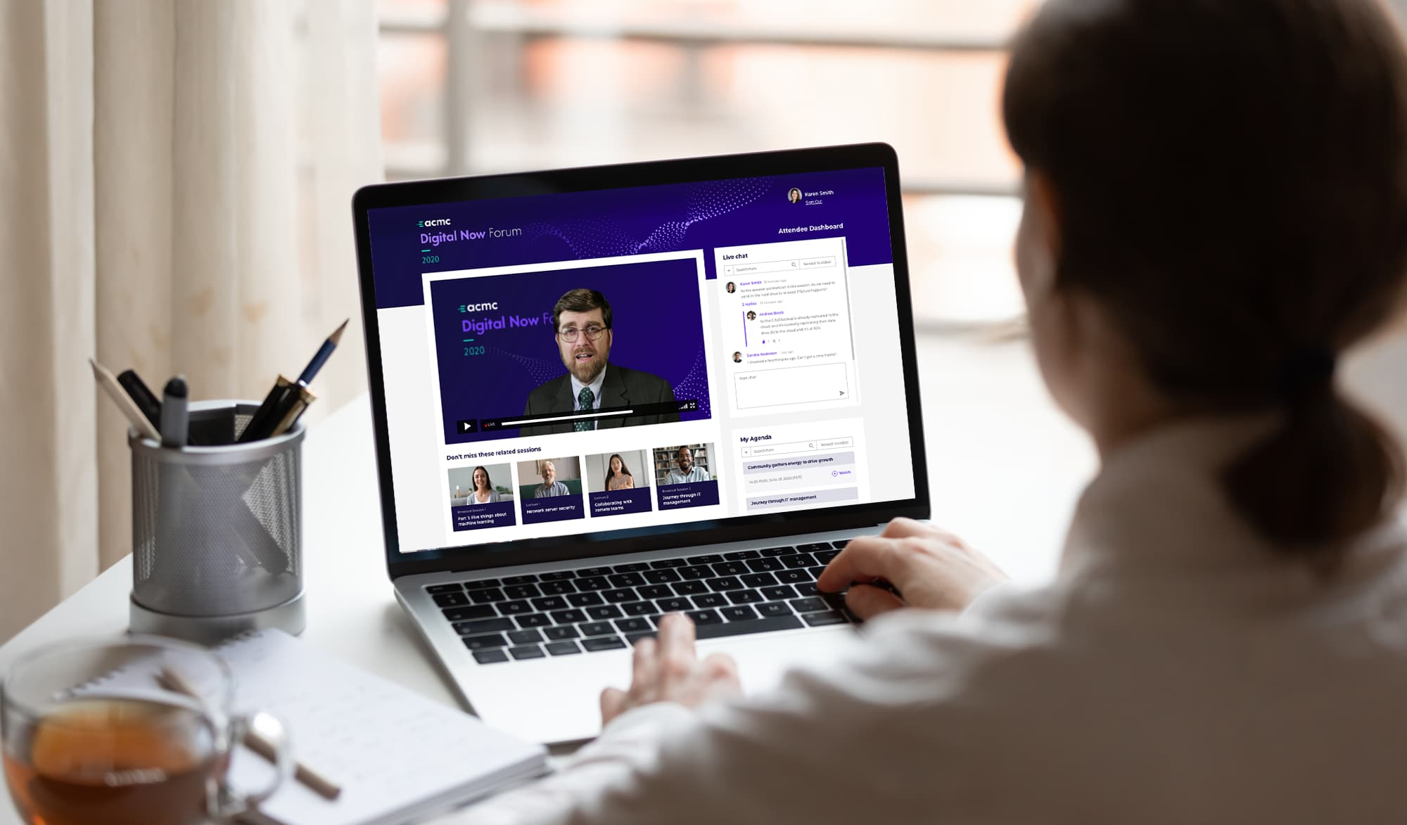 A business person working from home attends a virtual conference.